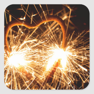Burning sparkler in form of a heart square sticker