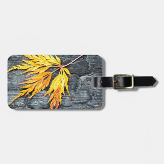 Burnt black wood with yellow leaf luggage tag
