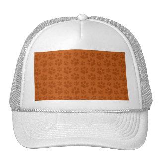 Burnt orange dog paw print pattern trucker hat