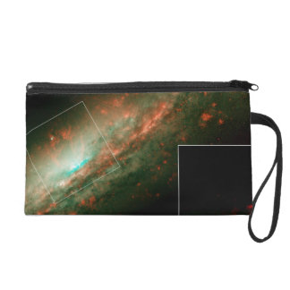 Burst of Star Formation Drives Bubble in Galaxy NG Wristlet Clutches