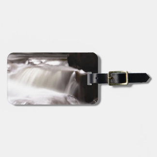 burst of water in creek luggage tag