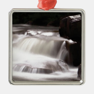burst of water in creek metal ornament