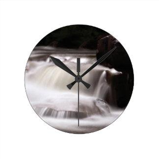 burst of water in creek round clock