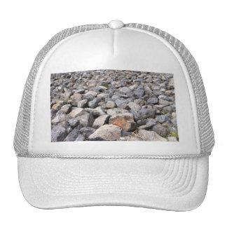 Bush setting of man made rock formation pattern trucker hat