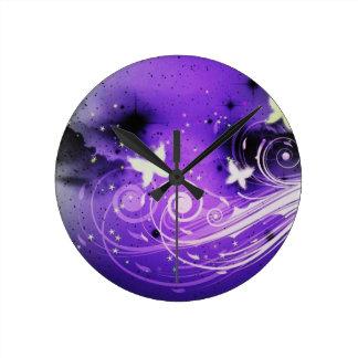 Butterflies and swirls round clock