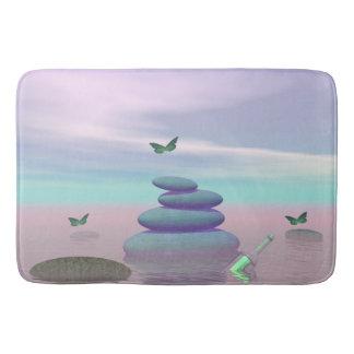 Butterflies in flight in a Zen landscape Bath Mat