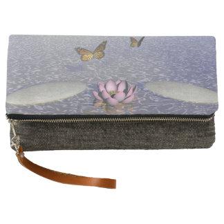 Butterflies in flight in a Zen landscape Clutch