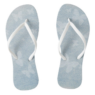 Butterfly design on faded blue jeans look flip flops