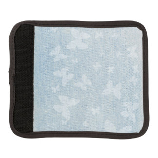 Butterfly design on faded blue jeans look luggage handle wrap