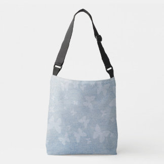 Butterfly design on faded denim look crossbody bag