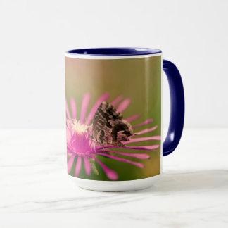 Butterfly on a purple wild flower mug
