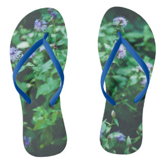 Butterfly on the wild flowers flip flops