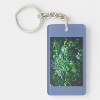 Butterfly on the wild flowers keychain