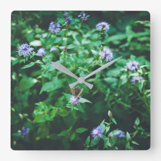 Butterfly on the wild flowers square wall clock