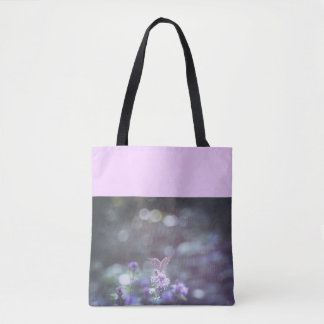 Butterfly on the wild flowers tote bag
