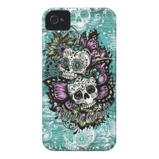 Butterfly sugar skulls on blue wood base. Case-Mate iPhone 4 cases