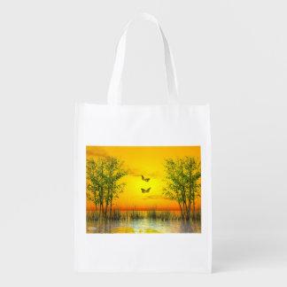 Butterlflies by sunset - 3D render Reusable Grocery Bag
