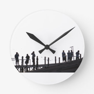 By the sea round clock