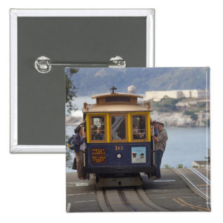 Cable car chugs up Hyde Street in San 2 Inch Square Button
