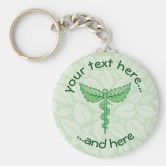 Caduceus with leaves background keychain