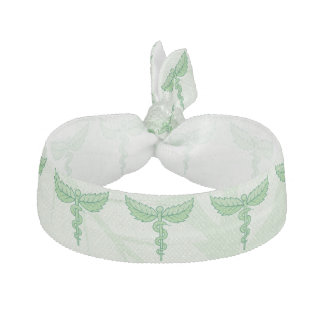 Caduceus with leaves background ribbon hair ties