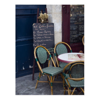Cafe table with cane chairs in Paris, France Postcard