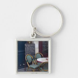 Cafe table with cane chairs in Paris, France Silver-Colored Square Keychain