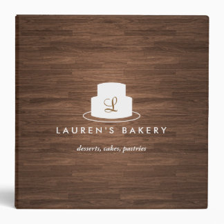 Cake Monogram Logo in White on Brown Woodgrain Vinyl Binder