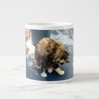 calico cat licking hind legs large coffee mug