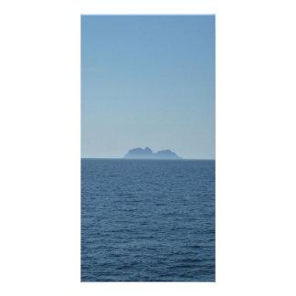 Calm blue sea with island in Lofoten, Norway card