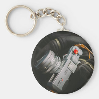 Camera hanging from neck of photographer basic round button keychain