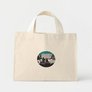 Camper Reading Sitting on Log Oval Woodcut Mini Tote Bag