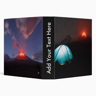 Camping at night on background of active volcano binder