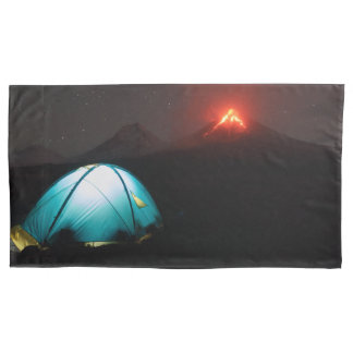 Camping at night on background of active volcano pillowcase