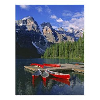 Canada, Alberta, Moraine Lake. Red canoes await Postcard