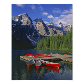 Canada, Alberta, Moraine Lake. Red canoes await Poster
