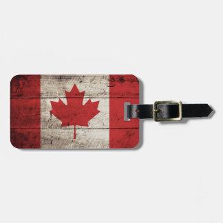 Canada Flag on Old Wood Grain Luggage Tag