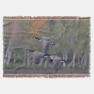 Canada geese in flight throw blanket