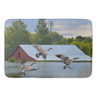 Canada Geese Landing On The Pond Bath Mat