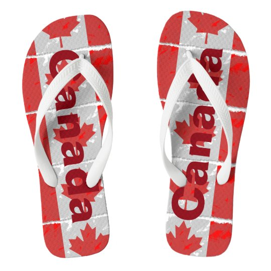7b71174ee01a29 Canadian Flag with Canada Printed in Red Flip Flops