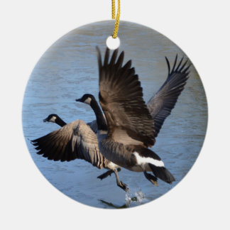 Canadian Geese Taking Flight Round Ceramic Ornament