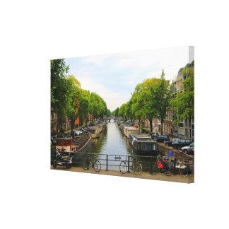 Canal, bridges, bikes, boats, Amsterdam, Holland Canvas Print