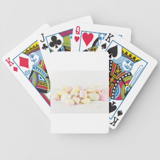 Candies marshmallows bicycle playing cards