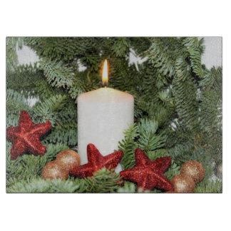 Candlelit piney ornament glass hol cutting board