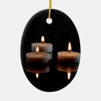 Candles on a mirror ceramic oval ornament
