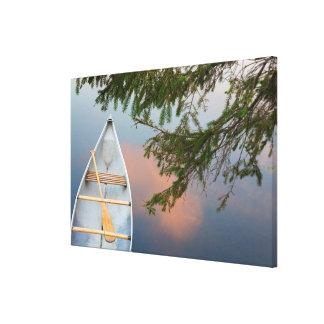 Canoe on lake at sunset, Canada Canvas Print
