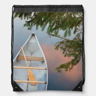 Canoe on lake at sunset, Canada Drawstring Bag