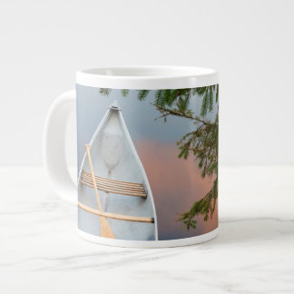 Canoe on lake at sunset, Canada Giant Coffee Mug