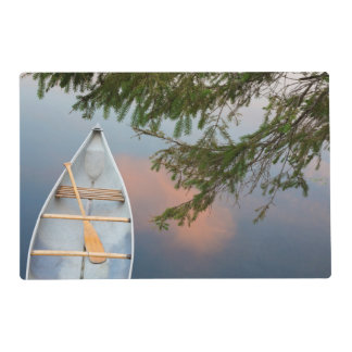 Canoe on lake at sunset, Canada Laminated Placemat