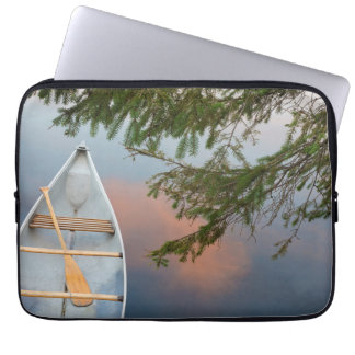 Canoe on lake at sunset, Canada Laptop Sleeve